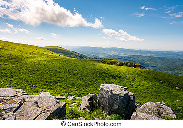 grassy slopes with huge rocks. beautiful mountainous...