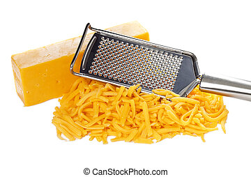 grated bar of cheddar cheese and metal grater