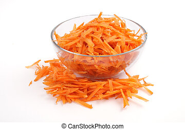 Grated carrots in a glass cup