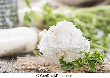 Grated Horseradish - Portion of grated Horseradish on wooden...