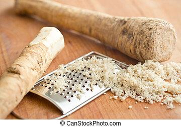 grated horseradish root on kitchen table