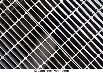 grateful - A close up of a Sewer grate