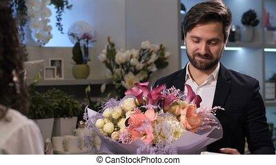 Grateful client receiving bouquet from florist - Closeup of ...
