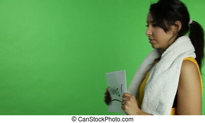 grateful Sport woman isolated green screen - model in studio...