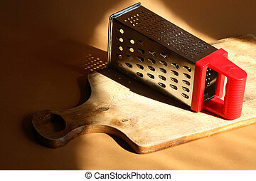 Grater On Cutting Board