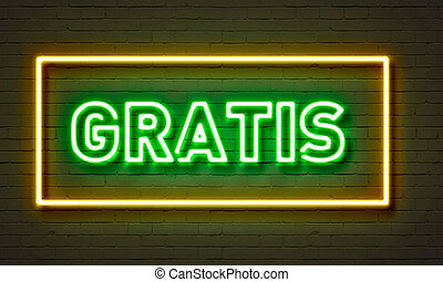 Gratis neon sign on brick wall background.