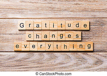 Gratitude changes everything word written on wood block. Gratitude changes everything text on wooden table for your desing, concept
