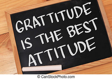 Gratitude is the best attitude, text words typography written on chalkboard against wooden background, life and business motivational inspirational