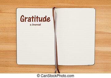 Gratitude journal on a wood desk