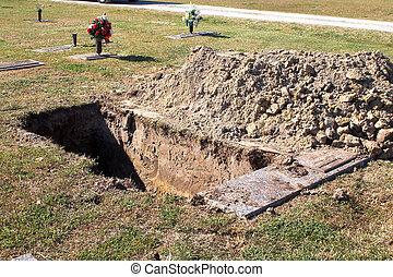 An open grave at a graveyard.