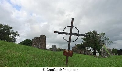 grave cross on celtic cemetery in ireland - ancient monument...