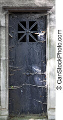 Grave Door - Scary dark grave door with spider webs all over...