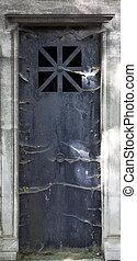 Grave Door - Scary dark grave door with spider webs all over...