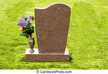 Grave Marker and Flowers - A headstone that is blank and can...