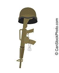 Grave soldier. Helmet and gun instead of cross. Badge Army. War tomb