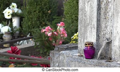 grave stone full of flowers and candles in day of all dead....