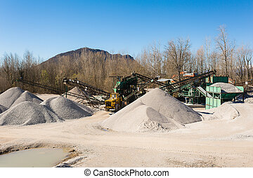 Extraction gravel. Machinery distribution and classification by size gravel. Conveyors for transporting gravel. Gravel quarry. Construction industry.