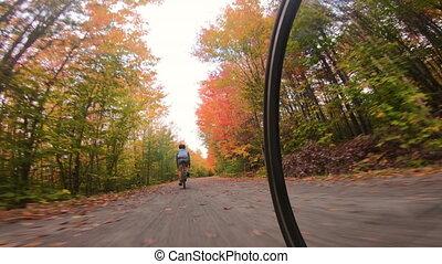 Gravel biking in fall. People biking riding gravel road ...