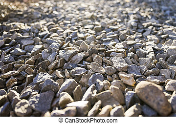 Gravel contrasts sun - Stone gravel during sunny day