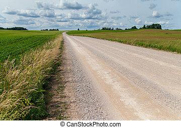 Gravel road in rural landscape.
