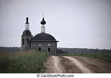 gravel road leading to old ortodox church