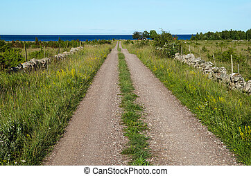 Gravel road straight to the sea - Summer view at a gravel...