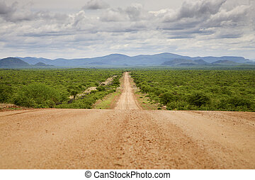 Gravel road with Zebra Mountains in Namibia