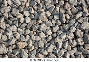 Gravel texture from the top. Artificially broken pebbles on the ground