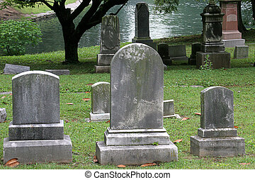 Gravestones By Lake - gravestones beside a lake in historic...