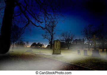 A spooky graveyard at sundown with mist