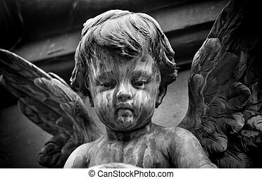 Statue of a baby angel on the graveyard