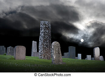 Graveyard in moonlight with moody sky