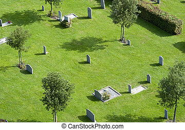 Neatly kept graveyard, seen from above on a lush summer day