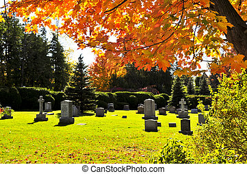 Graveyard with tombstones - Bright graveyard lawn with...