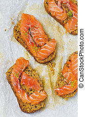 gravlax on bread with bran, traditional the Scandinavian snack. selective focus