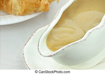 Close up of turkey gravy in a gravy boat.