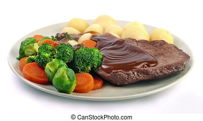 Gravy Poured On Meal Of Beef, Potatoes And Vegetables - Hot...