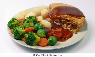 Gravy Poured On Meal Of Chicken Pie, Potatoes And Vegetables...