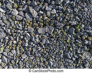 gray and green metallurgical slag macadam stone bedding - full frame background and texture.