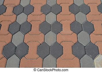 Gray and orange cement block pavement