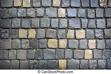 Gray and yellow paving stones Backgrounds and textures.