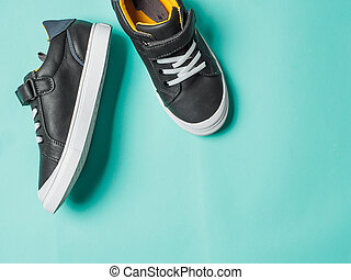 Gray and yellow sneakers on blue background