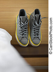 Gray and yellow sneakers