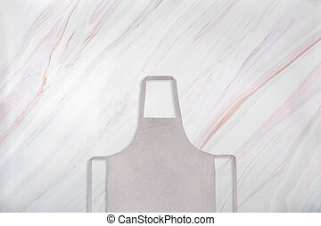 Gray apron on marble background. Flat lay