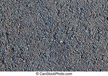 Gray asphalt as textured background or backdrop.