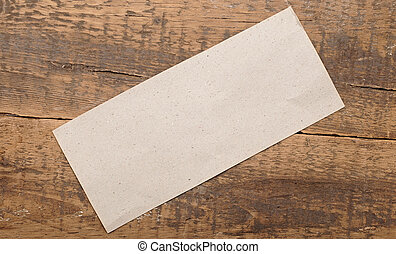 gray blank paper on old wood background