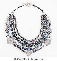 gray blue agate necklace from gemstones on white