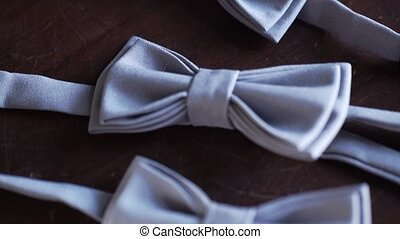 Gray bow tie on wooden background for bestman and groom at...