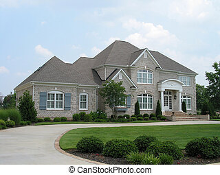 gray brick house in upscale neighborhood