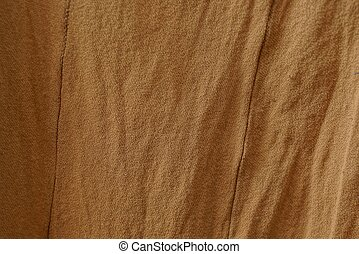 gray brown fabric texture from a piece of crumpled cloth
